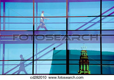 Stock Photography of People crossing glass bridge in Nordea Bank.