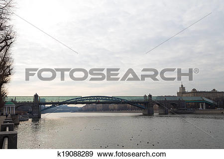 Stock Photograph of vaulted glass bridge over the river k19088289.