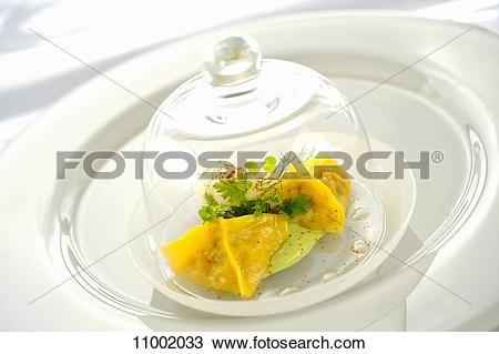 Stock Photo of Ravioli filled with king crab under a glass cloche.