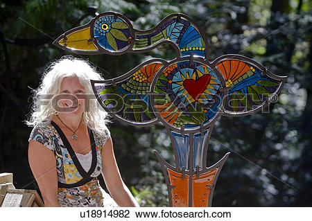 Stock Photo of An Artist displays her unique glass creation.