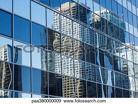 Stock Photograph of Skycrapers reflected on glass facade, low.