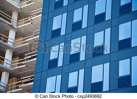 Stock Photo of glass facade and construction site.
