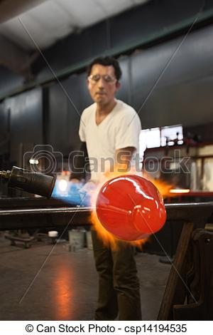 Stock Photos of Man Blasting Glass with Flames.