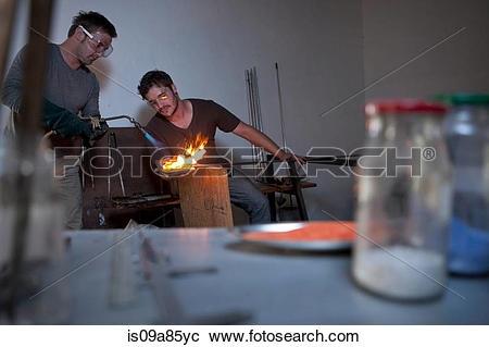 Stock Photography of Two men working in glass factory is09a85yc.