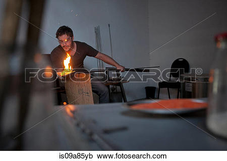Stock Photography of Man working in glass factory is09a85yb.