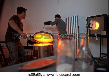 Stock Photography of Two men working in glass factory is09a85ya.