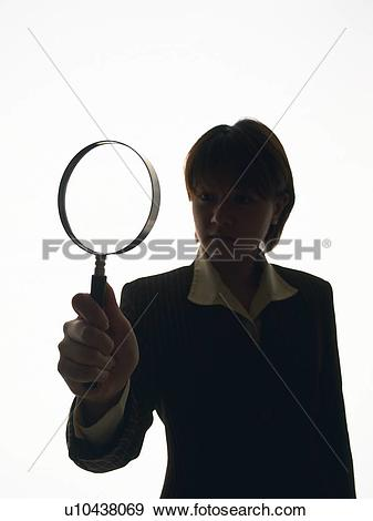 Stock Photograph of Bsinesswoman looking at something through.
