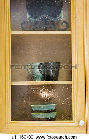 Stock Photography of Glass Front Kitchen Cabinet u11160700.