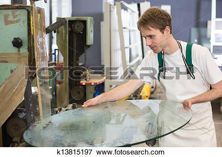 Picture of Glazier grinding a pieco of glass k13815197.