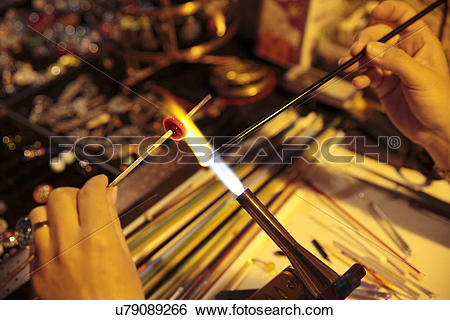 Stock Images of Woman making glass jewellery u79089266.