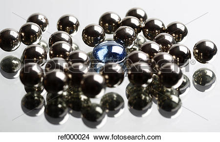 Stock Photo of Black pearls with blue glass stone on white.