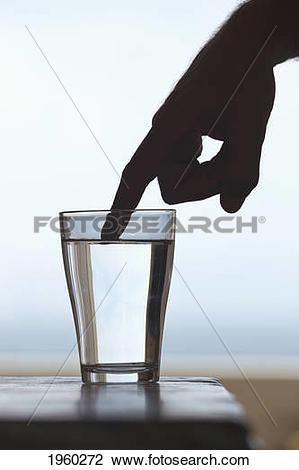 Stock Photo of outstretched finger of silhouetted hand touching.