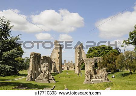 Stock Photo of England, Somerset, Glastonbury. Tourists strolling.