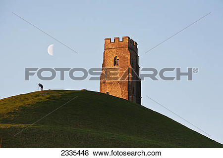 Pictures of Man Watching Moon With A Telescope Near Tower.