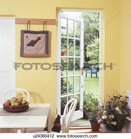 Stock Photo of Glazed door open to garden in traditional yellow.