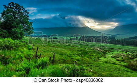 Stock Photography of Foggy dawn over the mountains of Glencoe in.