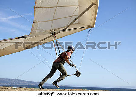 Stock Photograph of Hang glider pilot taking off is49a6q9.