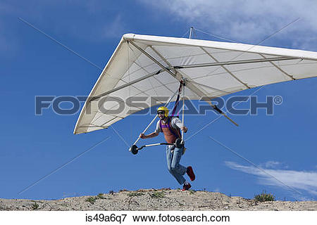 Picture of Hang glider pilot taking off is49a6q7.