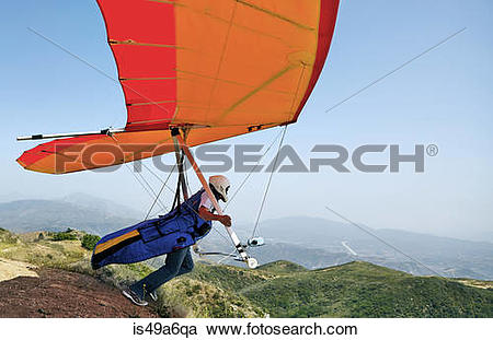 Stock Photography of Hang glider pilot taking off is49a6qa.