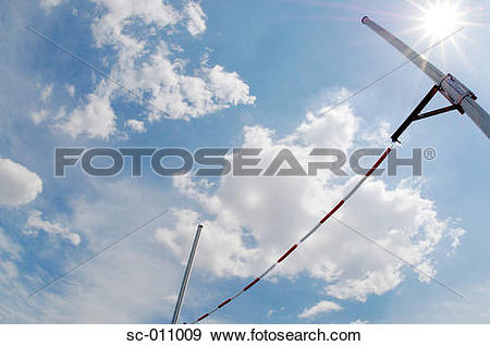 Stock Photograph of High Jump Bar Glistening In the Sun sc.