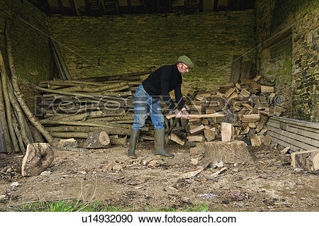 Stock Photography of Chopping Wood, Gloucestershire, England.