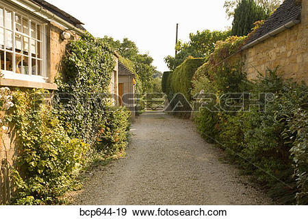 Stock Photograph of Alley between stone cottages, Gloucestershire.