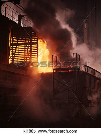 Stock Image of 1960s 1970s glowing coke oven steel mill production.