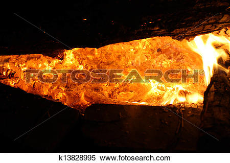 Stock Image of Close up of a bed of embers glowing in a campire.