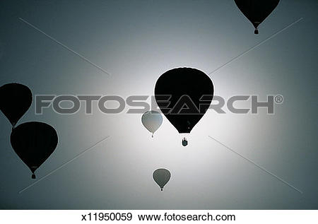 Stock Photograph of Six Hot Air Balloons Silhouetted Against.