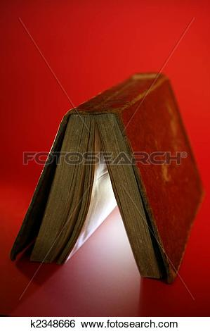 Stock Images of Old aged book close up, light glowing inside.