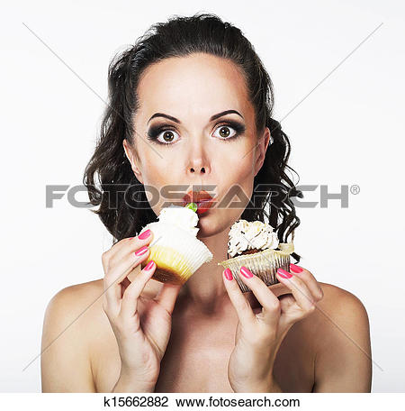 Stock Photo of Gluttony. Hungry Funny Young Woman Greedily Eats.