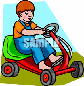 Image: A Boy Driving a Go Kart.