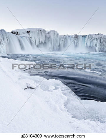 Stock Photograph of Godafoss waterfall frozen in winter, Iceland.