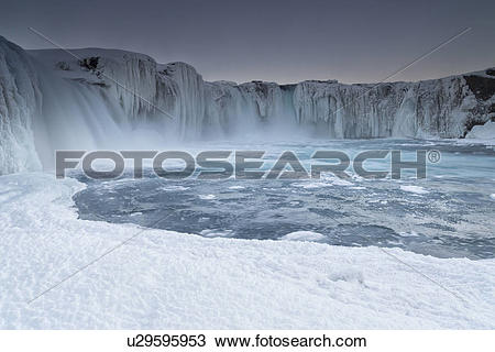 Stock Photo of Godafoss waterfall frozen in winter, Iceland.