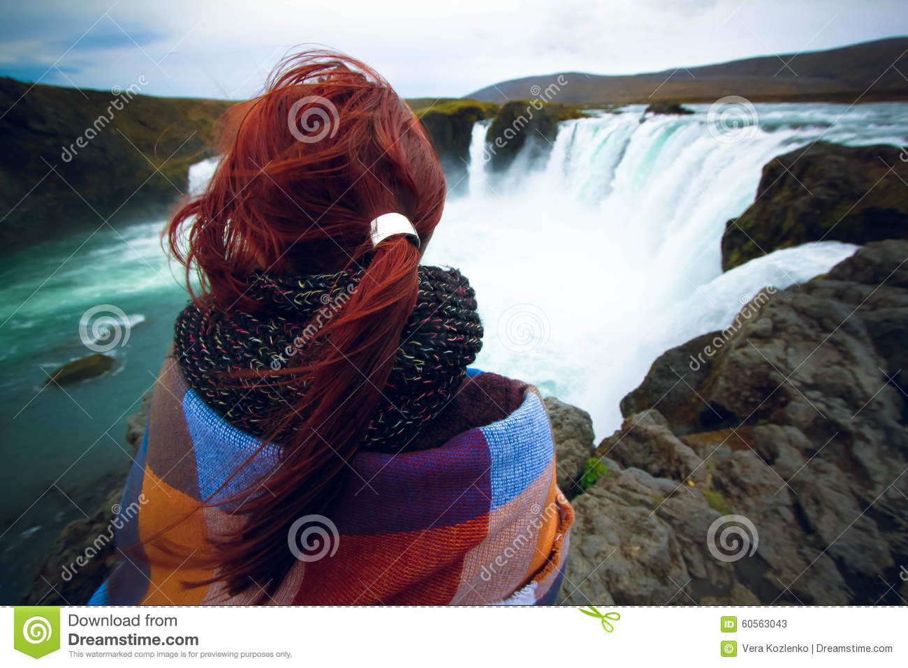 Girl Watching At Godafoss Waterfall, Iceland Stock Photo.