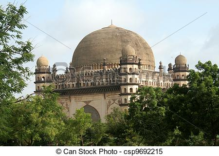Stock Images of Gol Gumbaz amidst Greenery.
