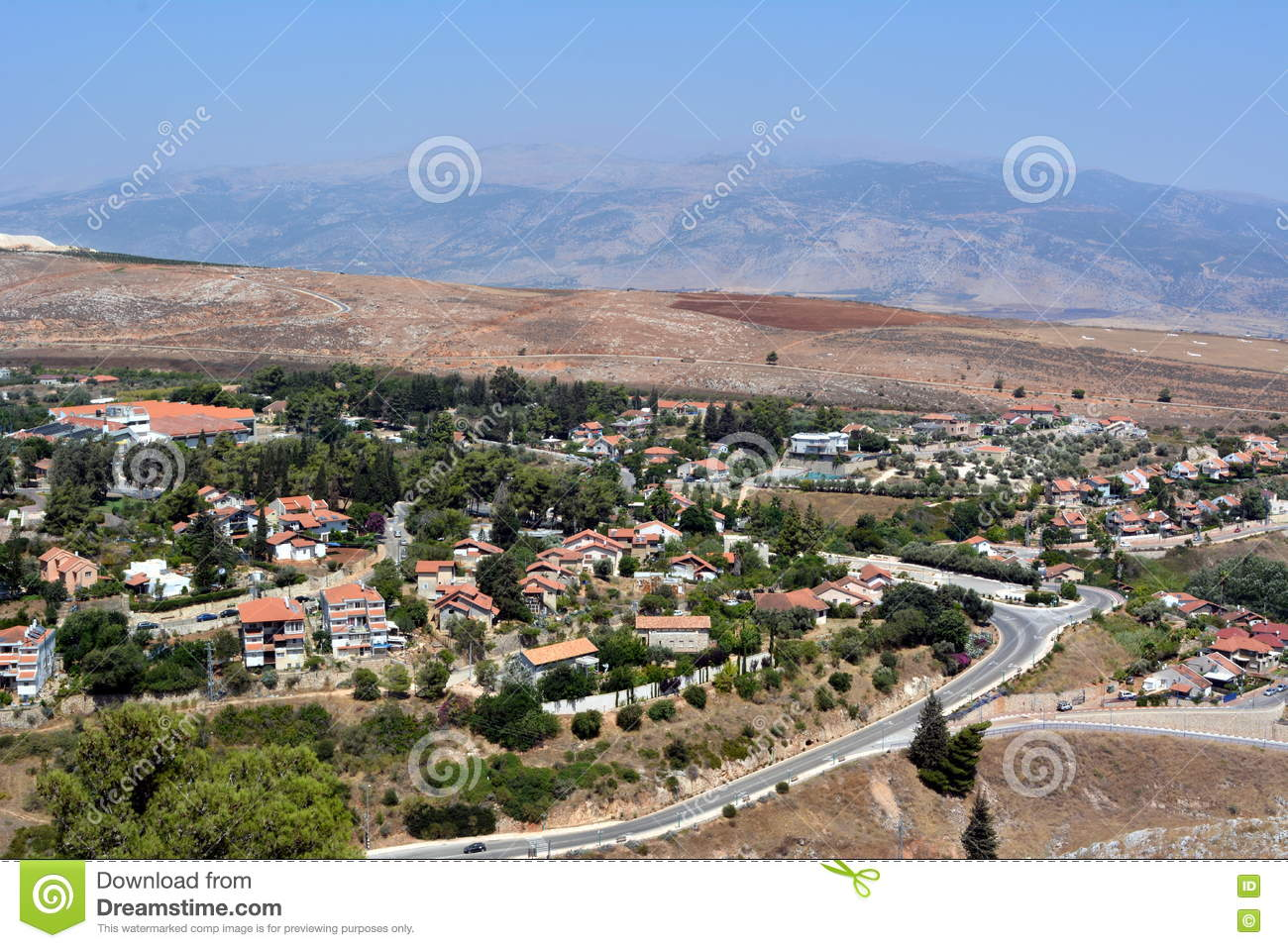 View Of The City Metula From The Golan Heights In Israel Stock.