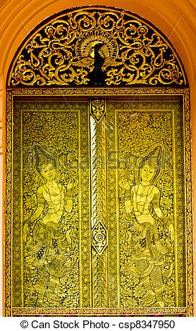 Stock Photography of Gold carved ancient door of temple Thailand.