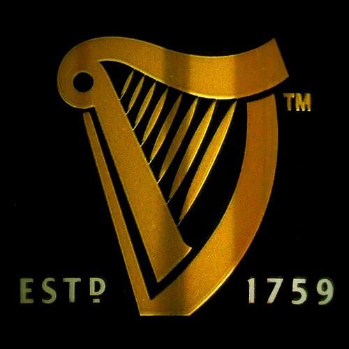 Answers Gold Harp Logo.