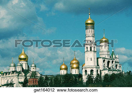 Stock Photo of Low angle view of golden cupolas, Bell Tower of.