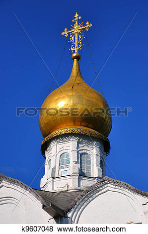Pictures of White orthodox church with a golden dome, Sergiev.