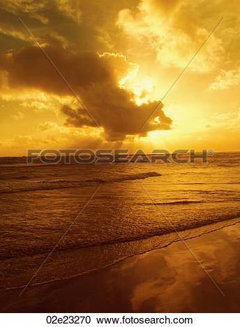 Stock Photography of Golden morning sunburst over ocean. 02e23270.