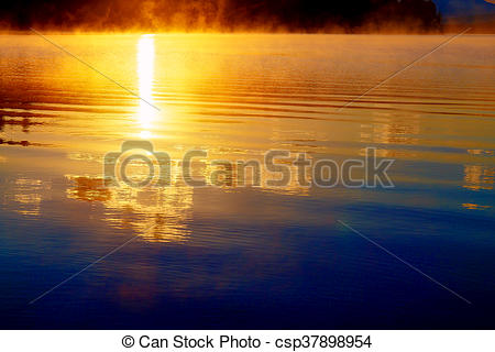 Stock Images of beautiful reflection of sun at down in golden.