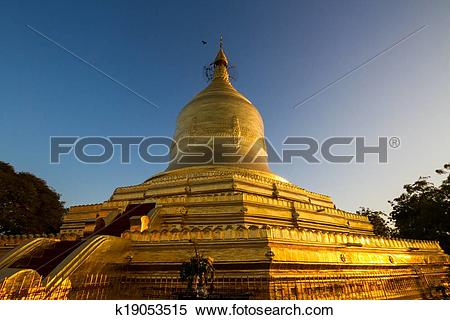 Stock Image of Golden pagoda on Irrawaddy river, Bagan, Myanmar.