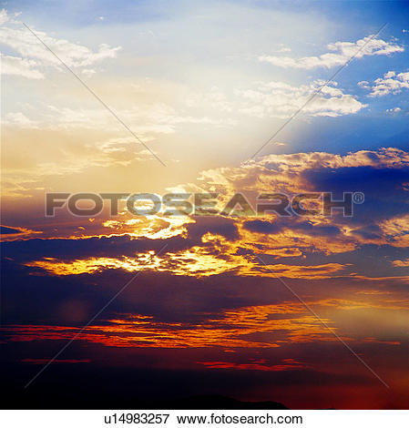 Picture of clouds, background, sunset, dusk, golden sky.