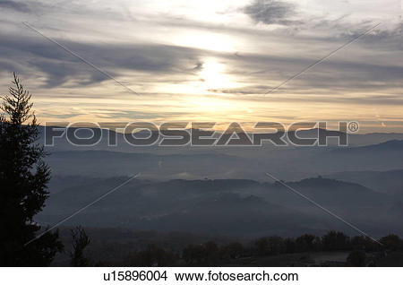 Stock Photo of Sunrise over Tiber valley with grey pink and golden.