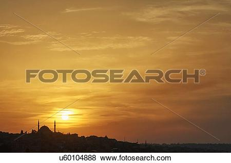Pictures of Sultan Ahmed Mosque silhouetted against golden sunset.