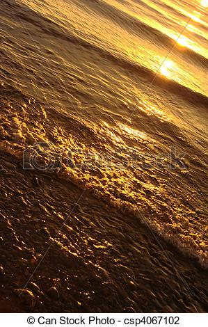 Stock Photo of Golden water waves.