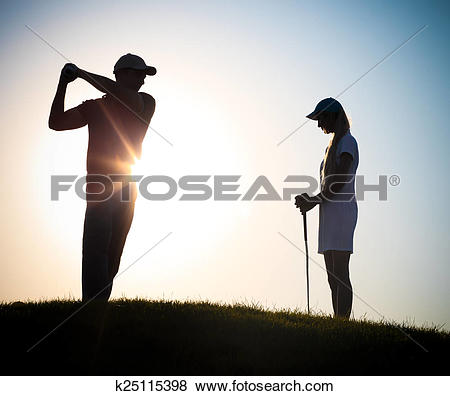 Pictures of Male and female golfers playing golf k25115398.