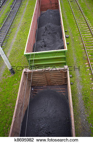 Stock Photo of Goods wagons with coal dust k8695982.